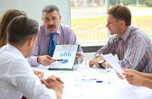 Manager discussing work with his colleagues — Stock Photo