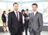 Two business men working together in the office — Stockfoto