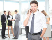 A young handsome business man on phone — Stock Photo