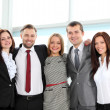 Successful business team laughing together - Stock Photo