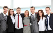 Successful business team laughing together — Foto Stock