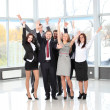 Successful business team laughing together — Stock Photo #19634825