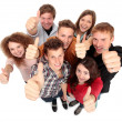 Group of happy joyful friends standing with hands up - Stock Photo