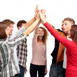 Foto Stock: Successful business team celebrating their success with a high five