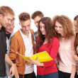Group of students talking and holding notebooks — Stockfoto