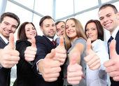 úspěšný mladý obchod ukazuje palec — Stock fotografie