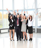 Successful business team laughing together — Stockfoto
