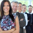Stylish young businesswoman with her successful business team at office — Stock Photo