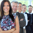Stylish young businesswoman with her successful business team at office - Stock Photo