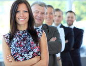Stylish young businesswoman with her successful business team at office — Stockfoto