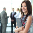 Beautiful woman on the background of business — Stockfoto