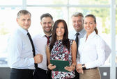 Successful business team laughing together — Stock Photo