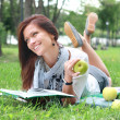 Beautiful portrait of a woman reading outdoors — Stock Photo #20048117
