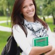 Stock Photo: Portrait of college student with book and bag