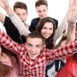 Foto Stock: Excited group of with arms up isolated