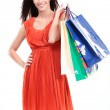 Portrait of young happy smiling woman with shopping bags — Stock Photo #20749457