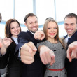 Happy diverse group of executives all pointing at you — Stock Photo #23765991