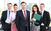 Group portrait of a professional business team looking confidently at camera — Stockfoto