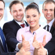 Successful young business people showing thumbs up sign - Stock Photo