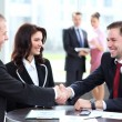 Business shaking hands, finishing up a meeting — Stock Photo #25321793