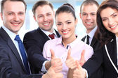 Successful young business showing thumbs up sign — Foto Stock