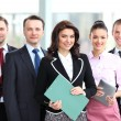 Group portrait of a professional business team looking confidently at camera — Stock Photo #25562447