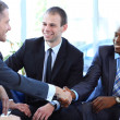 Business shaking hands, finishing up a meeting — Stock Photo #27000435