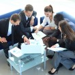 Top view of working business group sitting at table during corporate meeting — Stock Photo #27000613