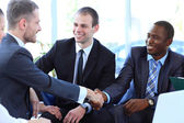 Business shaking hands, finishing up a meeting — Stock Photo