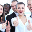 Successful young business showing thumbs up sign — Stock Photo #27819443