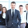 Stock Photo: Group portrait of a professional business team looking confidently at camera