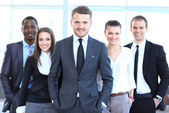 Group portrait of a professional business team looking confidently at camera — Stock Photo