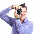 Young man with camera. Isolated over white background — Stock Photo