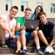 Friends and education, group of university students studying, reviewing homework and preparing test — Stockfoto