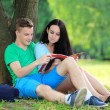 Two students studying with computer notebook outdoors — Foto Stock