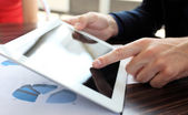 Hand touching on modern digital tablet pc at the workplace — Stock Photo