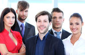 Closeup portrait of a successful business team laughing together — Stock Photo