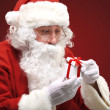 Photo of happy Santa Claus looking into white giftbox in isolation — Stock Photo #35417139