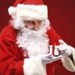Photo of happy Santa Claus looking into white giftbox in isolation — Stock Photo #35417223