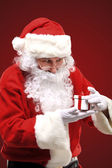 Photo of happy Santa Claus looking into white giftbox in isolation — Stock Photo
