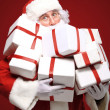 Stock Photo: Santa Claus with giftboxes