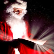 Santa looking into the sack — Stock Photo