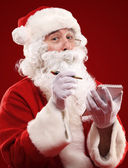 Santa Claus writing a list — Stock Photo