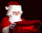 Santa looking into the sack — Stock Photo