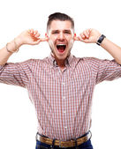 Frustrated Casual young man closing his ears with his hands — Stock Photo