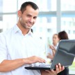 Smart business man using laptop — Stock Photo #40853591