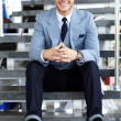 Business man sitting on stairs — Stock Photo