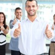 Stock Photo: Business team show thumbs up