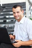 Businessman using laptop — Foto Stock