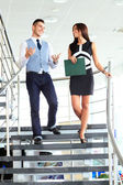 Business partners on the stairs — Stock Photo